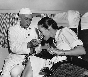 Nehru lighting a cigarette for the then British high commissioner's ...