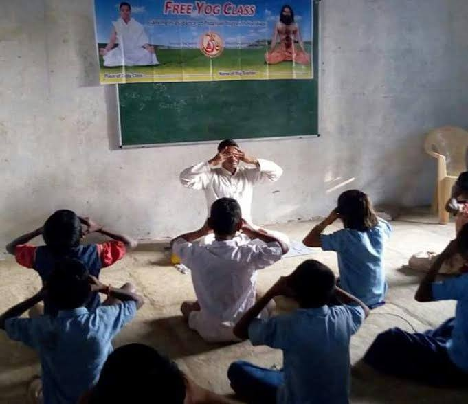 Free yoga classes are being taught in a village school in rural India. Yoga is very widespread and part of Indian culture especially among Hindus